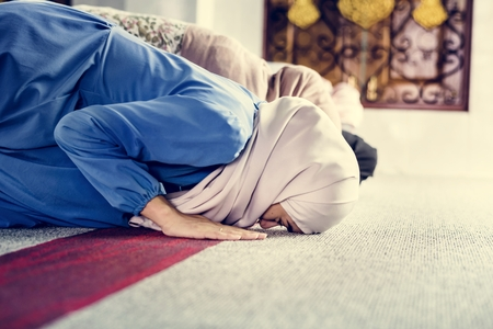 Muslim people praying in Sujud posture Stock Photo