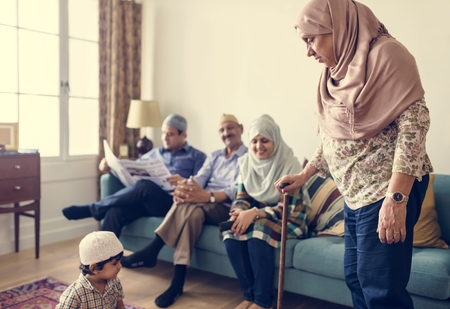 Muslim family relaxing in the home Stock Photo - 102863799