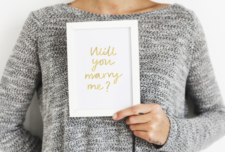 Woman asking will you marry me? Stock Photo