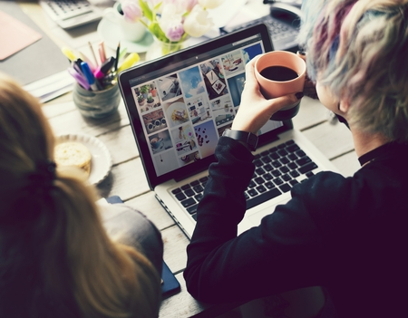 Artsy woman working with social media marketing Stock Photo