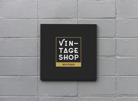 Black sign on a white wall mockup Stock Photo