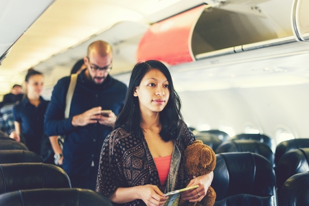 Asian girl traveling by airplane Stock Photo