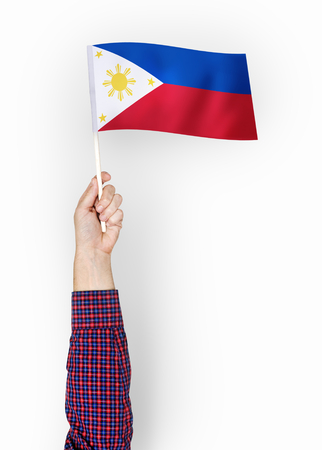 Person waving the flag of Republic of the Philippines