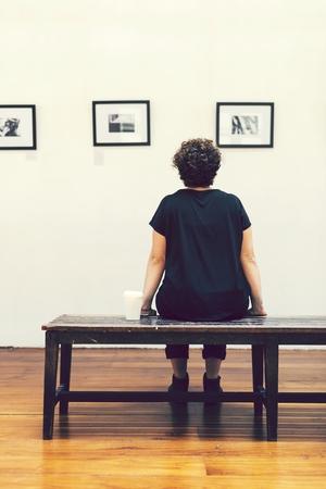 Woman at an art exhbition