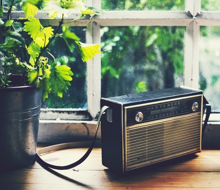 Closeup of a vintage radio on a wooden table Stock Photo