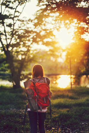 Girl traveling alone with her backpack 版權商用圖片