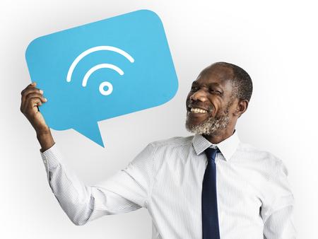 Happy man holding Wireless technology symbol