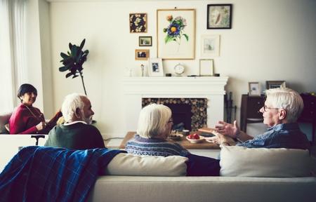 Senior people talking in the living room 版權商用圖片