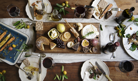 Rustic style dinner with cheese platter Stock Photo