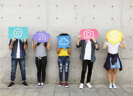 Teenagers covering their faces with social media icons