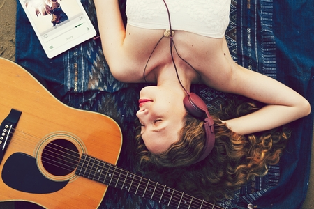 Girl relaxing and listening to music