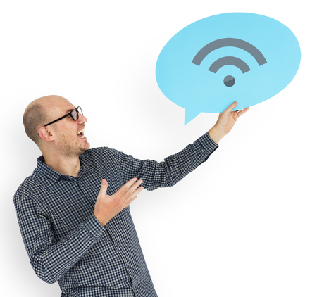 Happy man holding Wi-fi symbol Stock Photo
