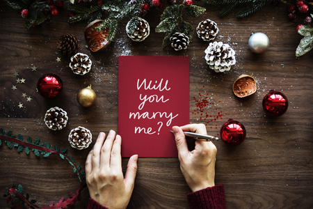 Christmas themed wedding proposal card Stock Photo