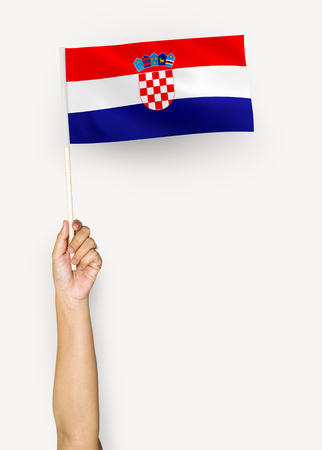 Person waving the flag of Republic of Croatia