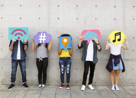 Teenagers covering their faces with social media icons Standard-Bild - 102864974