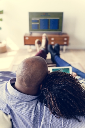 Couple watching TV at home together