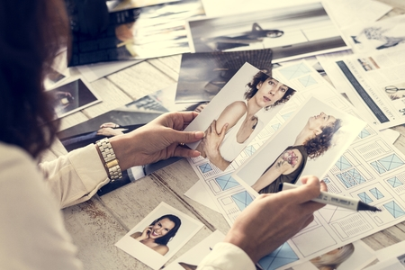 Magazine editor selecting models Stock Photo