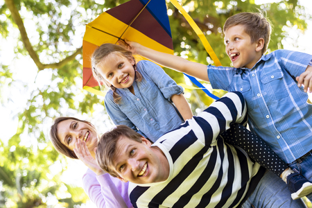 Family playing with a colorful kite