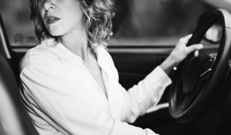 Woman driving a car in reverse Stock Photo