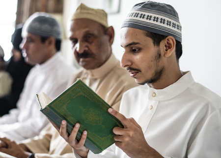 Muslims reading from the quran Stock Photo - 104048252