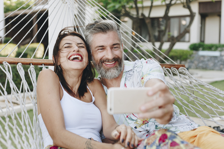 Couple taking a selfie while on vacation Stock Photo