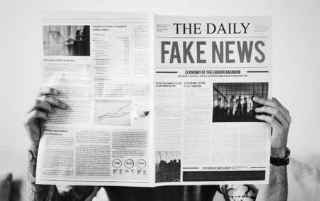 Fake news headline on a newspaper Archivio Fotografico