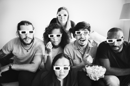 Group of friends watching 3D movie together Stock Photo