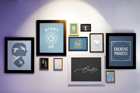 Picture frames with creative illustrations on a wall