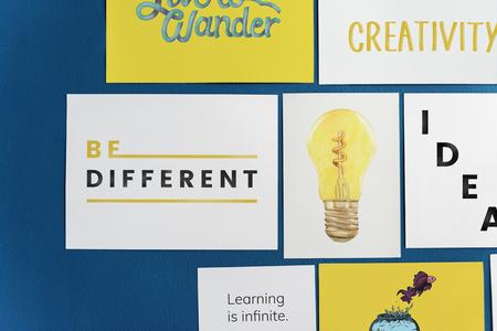 Creative postcard set on a blue wall