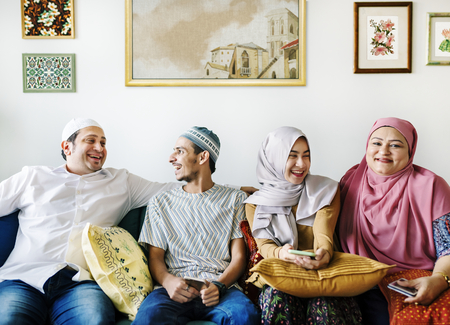 Muslim family relaxing in the home Stock Photo - 104049888