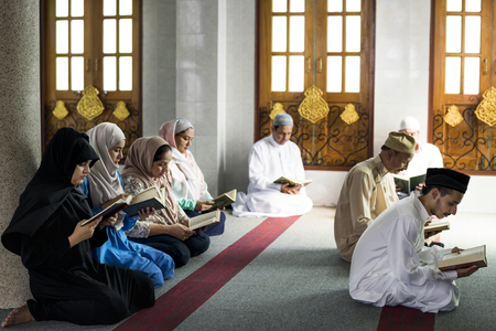 Muslims reading from the quran Stock Photo - 104050297