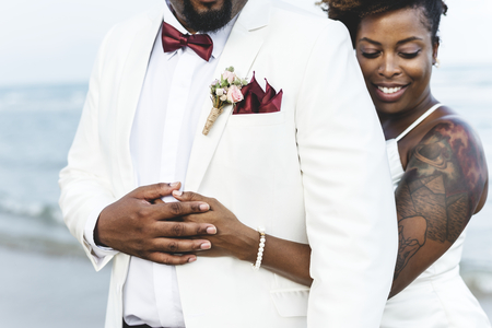 African American couple getting married at an island Banco de Imagens