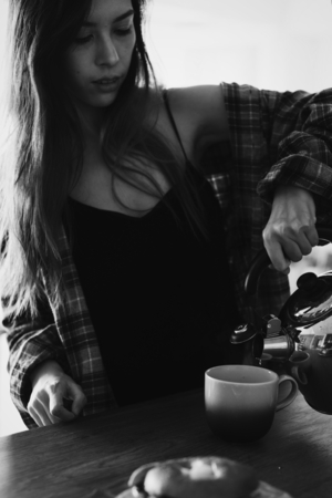 Young woman pouring a coffee