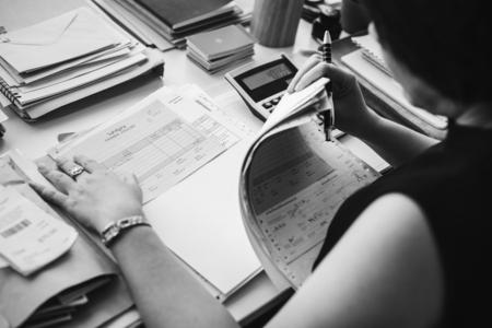 Asian woman working through paperwork