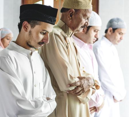 Muslim praying in Qiyaam posture Stock Photo