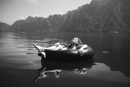 Woman relaxing on floating ring Stock Photo