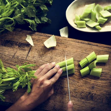 Cutting fresh vegetable with knife Banco de Imagens