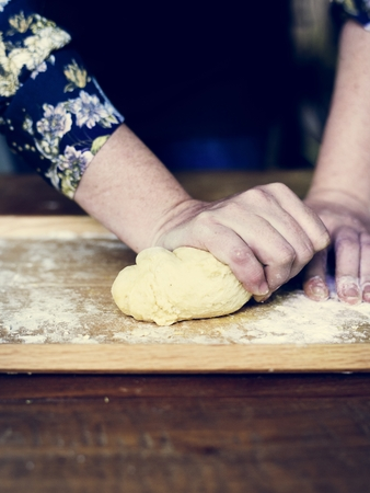 Close up of hands kneading dough for pastry