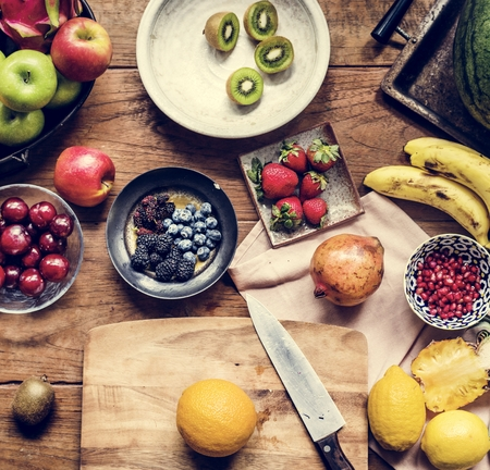 Various of fresh fruits on wooden table Imagens