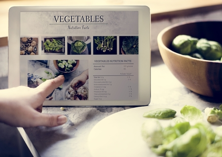 Vegetable nutrition facts information on a device screen Stock Photo