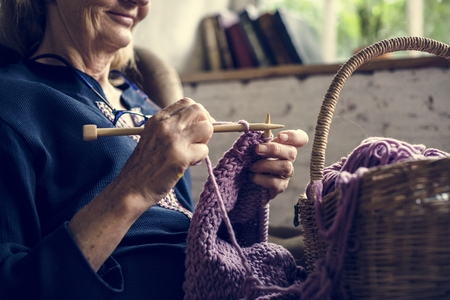 Elderly woman knitting handicraft hobby