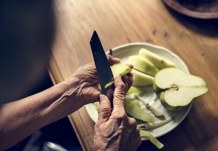 Peeling fresh pear fruit