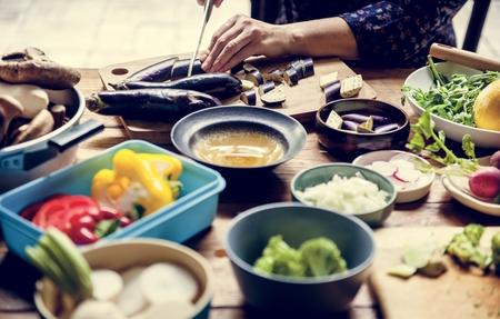 A person slicing vegetable Фото со стока