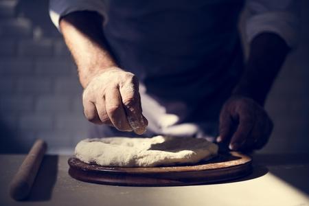 Hands preparing bread