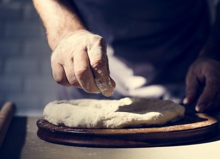 Closeup of hands making dough for bake 版權商用圖片