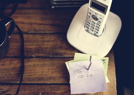 Closeup of landline phone on wooden table Stok Fotoğraf - 104002353