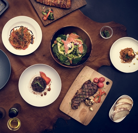 Mixed italian food plates on table