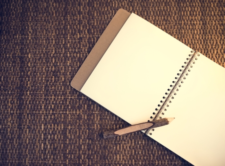 Notebook with pencil design space Stock Photo