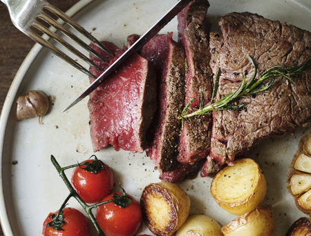 Close up of a cutting a fillet steak food photography recipe idea Stockfoto