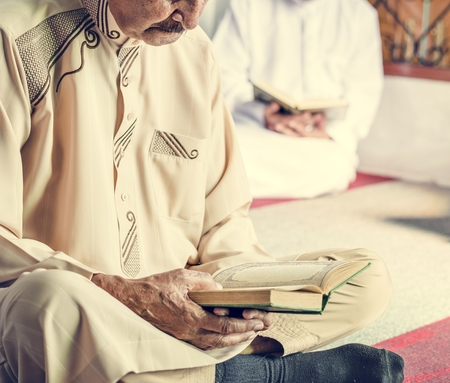 Muslims reading from the quran Stock Photo - 104031899